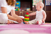 Playful baby with mother — Stock Photo