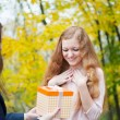 Young girl giving birthday present box — Stock Photo #14045487