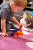 Two children playing in the room — Stock Photo
