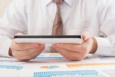 Modern businessman analyzing graphs — Stock Photo