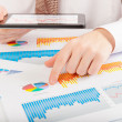 Stock Photo: Businessmanalyzing graphs and charts