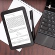 Laptop and digital tablet with mathematical article - Stock Photo