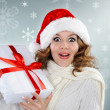 Beautiful young woman with Christmas present box — Stock Photo #14683279