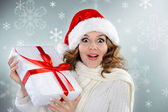 Beautiful young woman with Christmas present box — Stock Photo