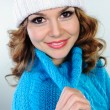 Portrait of beautiful young woman in blue knitted sweater — Stock Photo