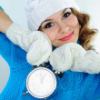 Young woman in winter clothes holding alarm clock — Stock Photo