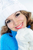 Smiling woman in knitted sweater, hat, and gloves — Stock Photo