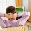 Young man watching tv at home — Stock Photo