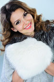 Beautiful woman with white fur muff — Stock Photo