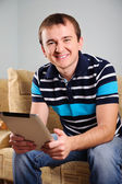 Young man with digital tablet at home — Stock Photo
