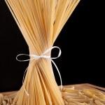 Ribbon tied bunch of spaghetti pasta — Stock Photo #15788943