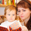 Mother with her little baby son reading book — Stock Photo #16801503