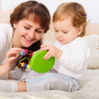 Young mother playing with her baby son — Stock Photo