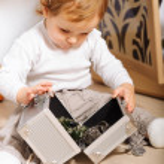 Baby boy playing indoors — Stock Photo