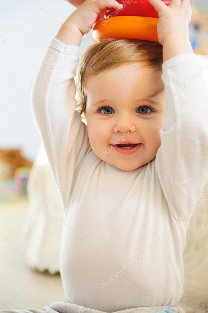 Cute baby boy playing with toys indoors  Stock Photo #16801557