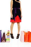 Young woman near colorful shopping bags — Zdjęcie stockowe