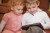 Two kids with digital tablet — Stock Photo