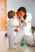 Mother and little son playing at home — Stock Photo