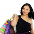 Young brunette with shopping bags isolated on white — Stock Photo