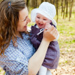 Young mother with little baby daughter in park — Stock Photo