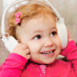 Little girl enjoying music with headphones — Stock Photo
