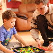 Boy and his father playing board soccer game at home — Stock Photo
