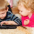 Stock Photo: Two kids with digital tablet