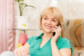 Attractive woman on the phone — Stock Photo