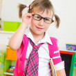 Cute little girl win eyeglasses and necktie — Stock Photo