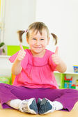 Cute funny girl showing thumbs up — Stock Photo