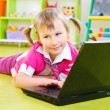Royalty-Free Stock Photo: Cute little girl with laptop on floor