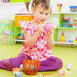 Little girl painting eggs for Easter holidays — Stock Photo #19933893