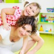Happy mother with little daughter at home — Stock Photo