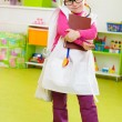 Cute little girl playing in doctor — Stock Photo
