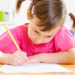 Foto Stock: Cute little girl study at home