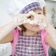 Little girl cooking in kitchen — Stok fotoğraf