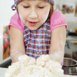 Little girl cooking in kitchen — Stockfoto