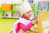 Cute little girl playing in doctor — Стоковое фото