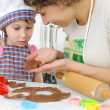 Young mother with little daughter preparing cookies — Stock Photo #20422553