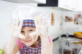 Little girl cooking in kitchen — Стоковое фото