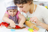 Mother with daughter making cookies — Stock Photo