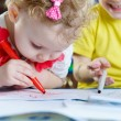 Little brother and sister drawing with felt-tip pens at home — Stock Photo