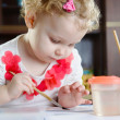 Cute little girl painting at home — Stock Photo