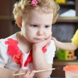 Thoughtful little girl with paintbrush — Foto Stock