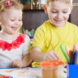 Smiling little brother and sister painting at home — Stock Photo