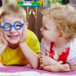 Funny brother in glasses with sister — Stockfoto