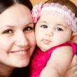 Closeup portrait of beautiful young mother with daughter - Foto de Stock