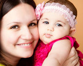 Closeup portrait of beautiful young mother with daughter — Stock Photo