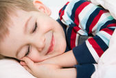 Little cute boy sleeping in bed — Stock Photo