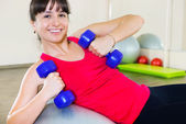 Happy young fitness woman — Stock Photo